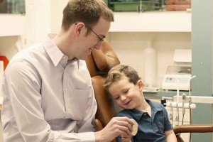 Dr. Eric Berkner with young patient